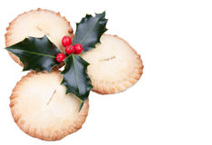 Christmas mince pies with holly. Traditional christmas mince pies with holly isolated on white Stock Image
