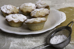Christmas mince pies with the sieve of icing sugar Stock Images