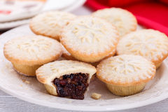 Christmas mince pies. Sweet and spicy Christmas mince pies stacked on white plate Stock Image