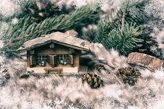 Christmas miniature cottage on winter background concept stock photography