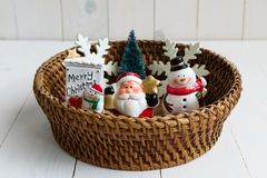 Christmas miniature model decoration on basket Stock Photos