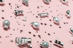 Christmas minimalistic pink background with silver decorations. Top view, flat lay.  stock image