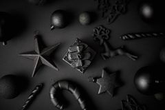 Christmas minimalistic and simple composition in mat black color. Christmas gifts, decorations on black background. Flat lay, top view royalty free stock images