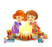 Christmas miracle - girls opening a magic gift Stock Photo