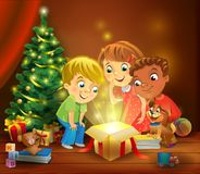 Christmas miracle - kids opening a magic gift beside a Christmas tree stock illustration