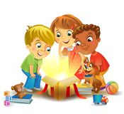Christmas miracle - kids opening a magic gift beside a Christmas tree Royalty Free Stock Photo