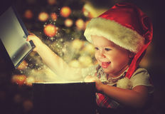 Christmas miracle, magic gift box and child baby girl royalty free stock photo