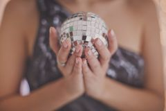 Christmas mirror ball in the hands of a girl stock photography