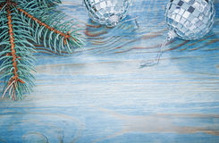 Christmas mirror balls fir twig on wooden board holidays concept Royalty Free Stock Images