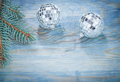 Christmas mirror balls pine twig on wooden board holidays concep Stock Photography