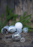 Christmas Mirror balls on wooden background Stock Photo