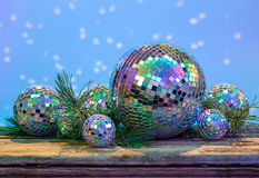 Christmas Mirror balls on wooden background Stock Images