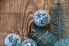 Christmas mirror disco balls and branch of pinetree on old woode Royalty Free Stock Image