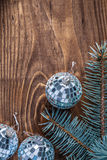 Christmas mirror disco balls and branch of pinetree on old woode Stock Photo