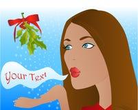 Christmas mistletoe kiss. Woman blowing a kiss underneath a mistletoe Stock Images