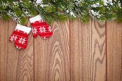 Christmas mitten decor and snow fir tree Stock Photography