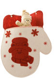 Christmas mitten with little snowman. Christmas mitten with little toy snowman royalty free stock photography