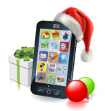 Christmas Mobile Phone. With Santa hat gift and baubles Royalty Free Stock Image