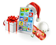 Christmas Mobile Phone. With Santa hat, gift, cracker and bauble Royalty Free Stock Photography