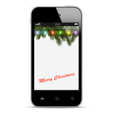 Christmas mobile phone with lights on branch of fir Stock Photography