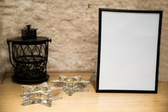 Christmas mock up with photo frame and small lantern 2018. Decoration greetings candlestick Stock Photos