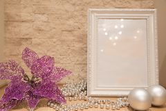 Christmas mock up, silver beads, Christmas balls, flowers decoration and brick wall background. Copy space. royalty free stock image