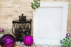 Christmas mock-up. Space for greeting. VIolet and purple Christmas balls. royalty free stock image