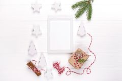 Christmas Mock Up With Photo Frame, Eco Gift Boxes And Tree Branches. New Year Celebration, Holiday Concept. Stock Photography