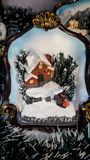Christmas model of a house surrounded by snow and trees Royalty Free Stock Images