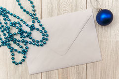 Christmas mokup with empty envelope,blue bead and balls.New Year Stock Images