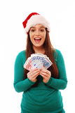 Christmas money. Portrait of an excited girl holding a fan of euro notes over a white isolated background Stock Photography