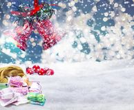 Christmas money, Euro lie under bells in the snow royalty free stock images