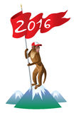 Christmas monkey with the flag. A monkey with a flag wishes everyone a happy new year of the monkey according to the Chinese calendar Stock Image