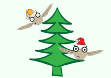 Christmas monsters on fir-trees. The flying Christmas monsters in caps on a green fir-tree Stock Images