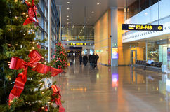 Christmas mood in the airport. Decorations, christmas trees Stock Image