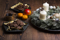 Christmas mood with biscuits, red wine and christmas decoration Royalty Free Stock Photography