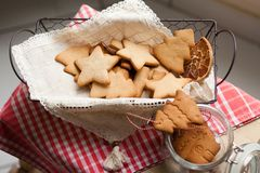 Christmas mood: family time, cooking gingerbread biscuits royalty free stock photo