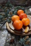 Christmas mood: mandarins in a Holiday decoration Royalty Free Stock Image