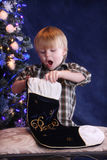 Christmas Morning. Child surprised by opening his christmas stocking stock photos