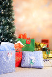Christmas Morning. Gifts and christmas tree background set up traditionally stock image