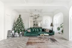 Christmas morning. classic luxurious apartments with decorated christmas tree. Living hall large mirror, green sofa. Christmas morning. classic luxurious stock images