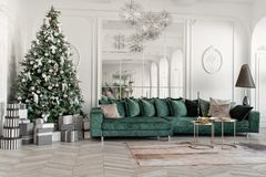 Christmas morning. classic luxurious apartments with decorated christmas tree. Living hall large mirror, green sofa. Christmas morning. classic luxurious royalty free stock images