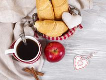 Christmas morning coffee top view. Fragrant croissants, Christmas decorative ornaments, hot coffee in mugs Stock Photo