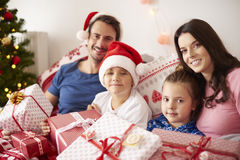 Christmas morning. Family spending Christmas morning in bed Royalty Free Stock Photography