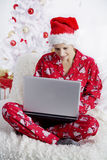 Christmas morning with laptop Stock Image