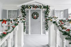 Free Christmas Morning. Porch A Small House With A Decorated Door With A Christmas Wreath. Winter Fairy Tale. Royalty Free Stock Images - 144846589