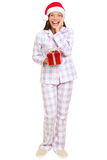 Christmas morning santa woman holding gift Stock Photos