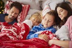 Christmas morning. Sleeping family in Christmas morning Stock Image