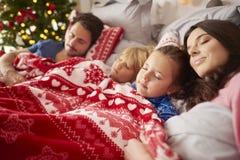 Christmas morning. Sleeping family in Christmas morning Stock Photo