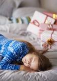 Christmas morning. Sleeping girl in Christmas morning Royalty Free Stock Photos